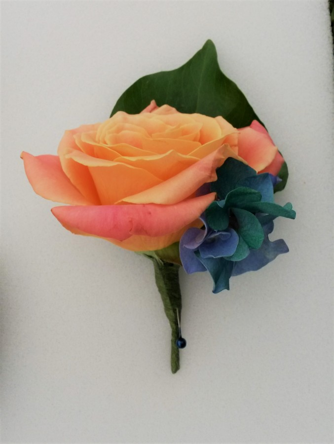 Coral Rose with Blue Hydrangea in the Buttonholes category