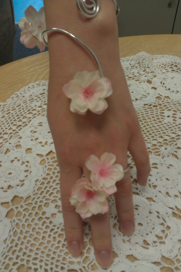 Silver bespoke wire ring with silk flowers in the Ladies buttonholes & Corsages category