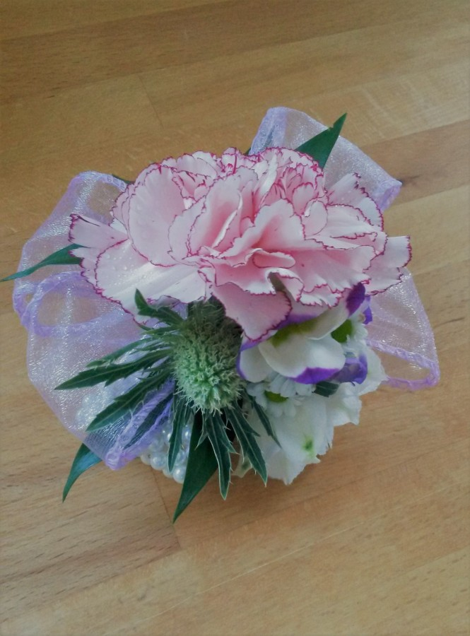 Pear corsage with Thistle, Carnation, Lisianthus & accent ribbon in the Ladies buttonholes & Corsages category