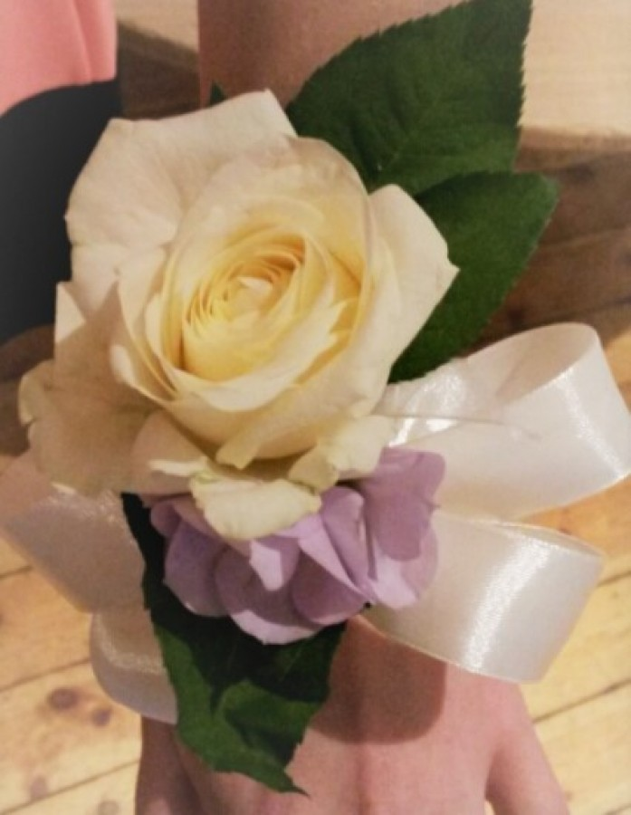 Pear Wrist Corsage with Large White Rose & Lilac Lisianthus in the Ladies buttonholes & Corsages category