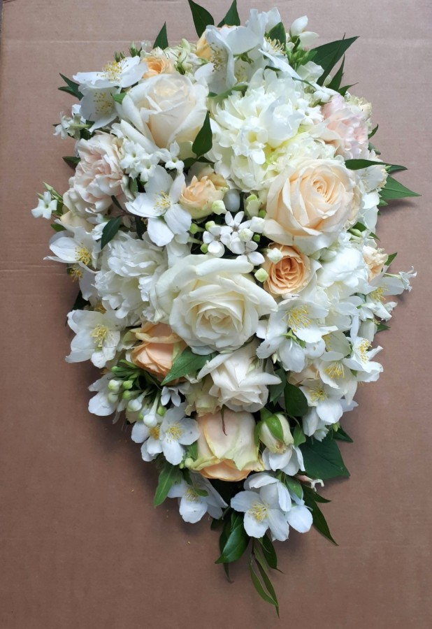 peach and cream cascade in the Wedding Bouquets category